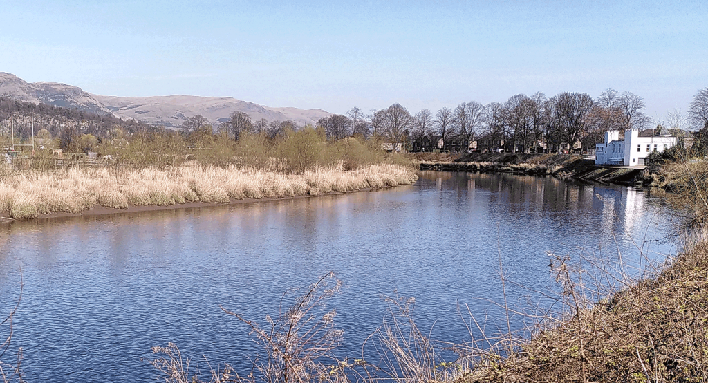 river in Stirling, Scotland, with hills